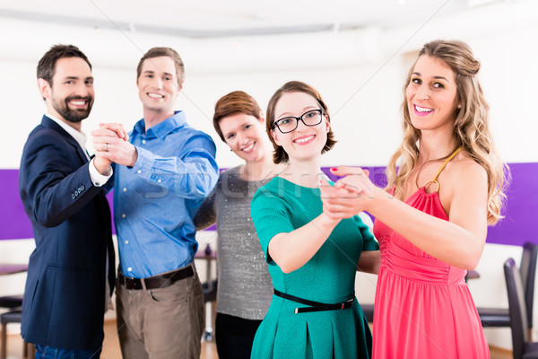 Dance instructor with gay couples in dancing class Stock photo © Kzenon