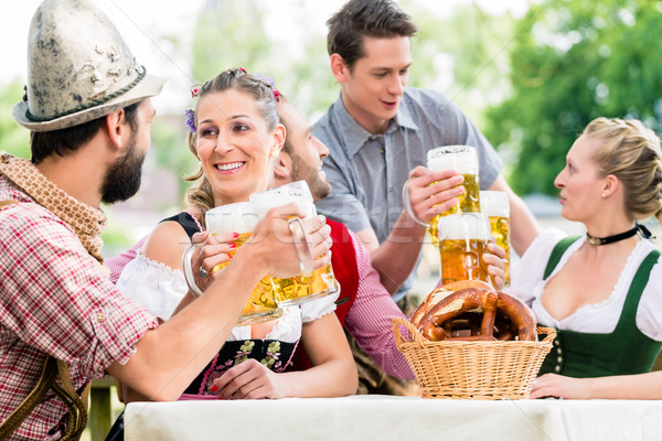 Friends in Bavarian beer garden drinking in summer Stock photo © Kzenon