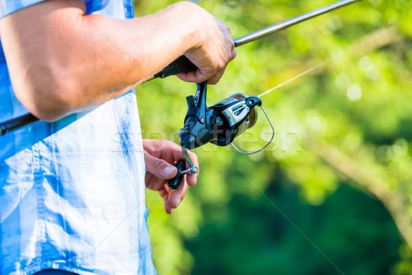 étroite coup sport pêcheur ligne canne à pêche Photo stock © Kzenon