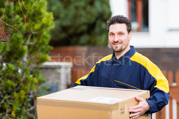 Courier delivering parcel to recipient Stock photo © Kzenon