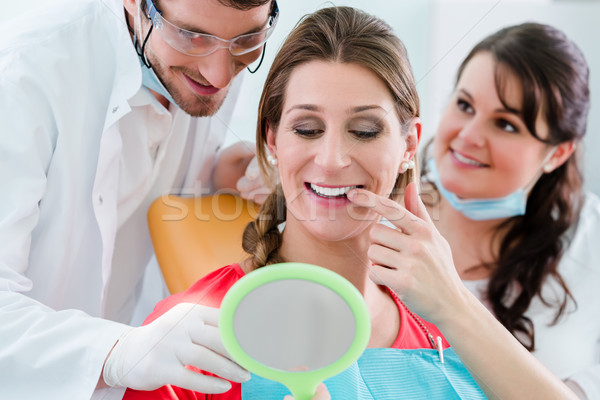 Kadın diş dişçi dişler ayna adam Stok fotoğraf © Kzenon