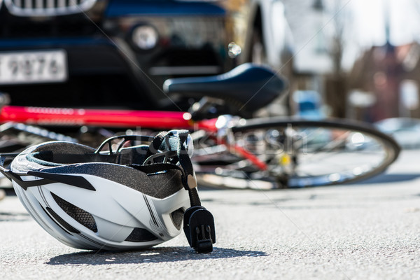 Close-up of a bicycling helmet on the asphalt  next to a bicycle Stock photo © Kzenon