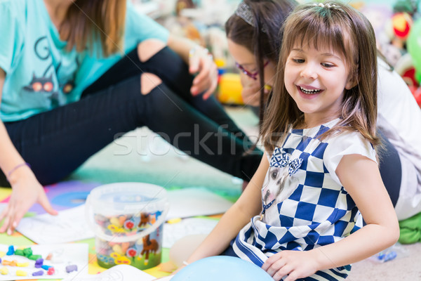 Cheerful pre-school girl wearing a trendy T-shirt while playing  Stock photo © Kzenon