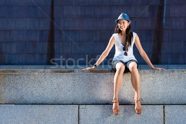 Asian seduta giù esterna sorridere Foto d'archivio © Kzenon