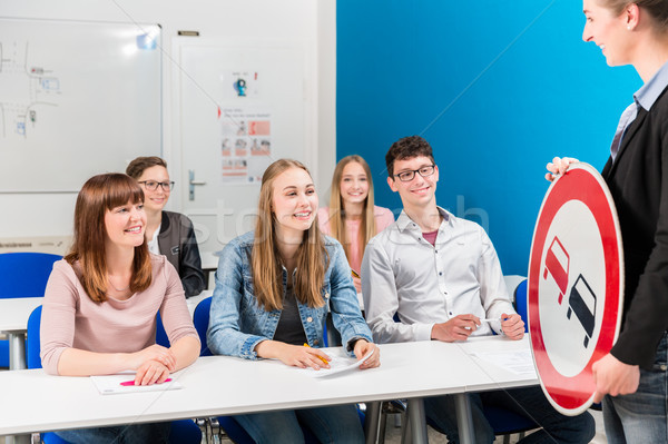 Students listing to their teacher in driving class Stock photo © Kzenon