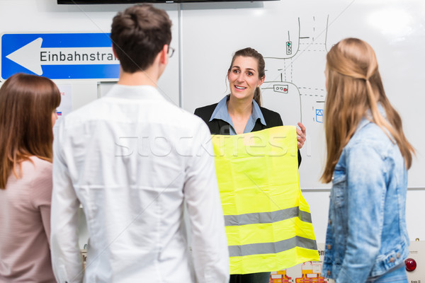 Driving instructor explain the importance of a safety vest Stock photo © Kzenon