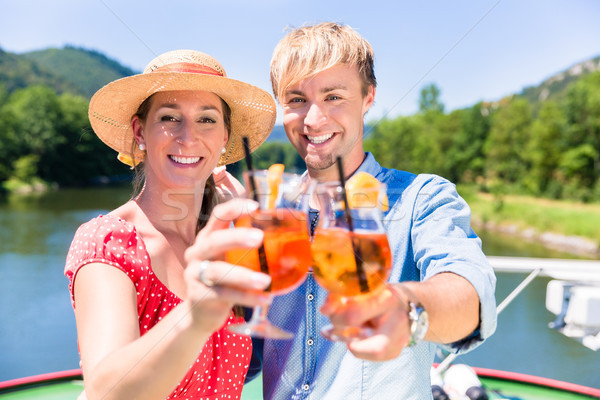 Couple in love on river cruise drinking coctails in summer Stock photo © Kzenon