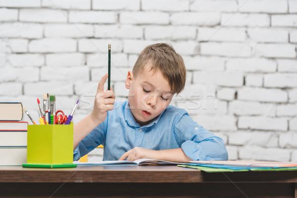 Pupil doing homework having an idea Stock photo © Kzenon