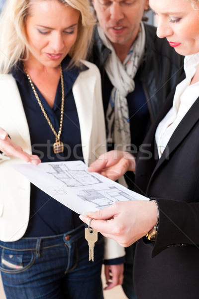 Young realtor explains lease agreement to couple Stock photo © Kzenon