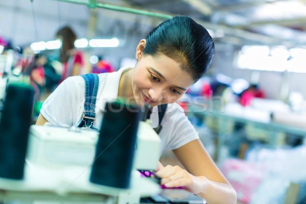 Indonesian seamstress in a textile factory Stock photo © Kzenon
