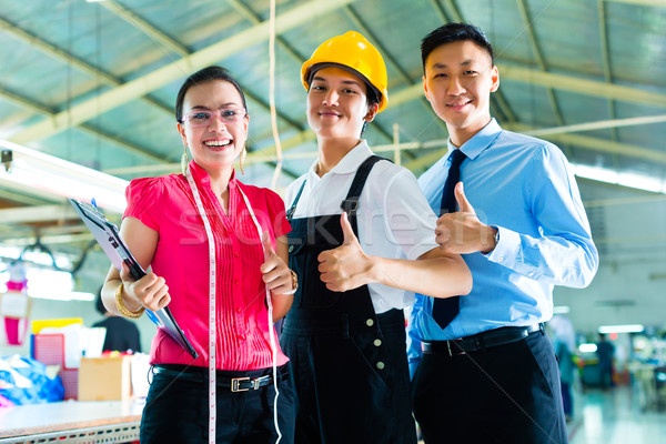 Worker, manager and designer in Chinese factory Stock photo © Kzenon