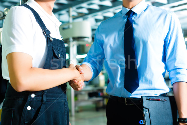 Worker and production manager in a factory Stock photo © Kzenon
