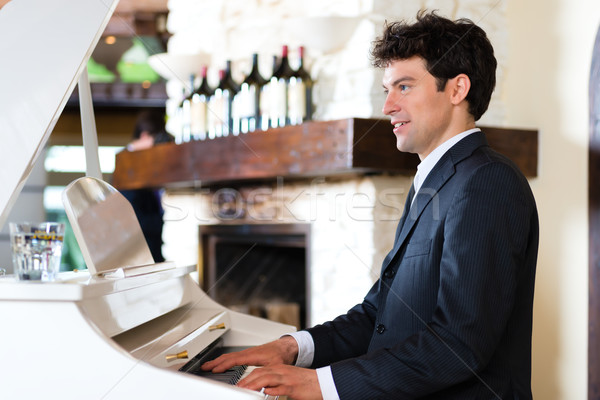 Pianist in a fine restaurant Stock photo © Kzenon
