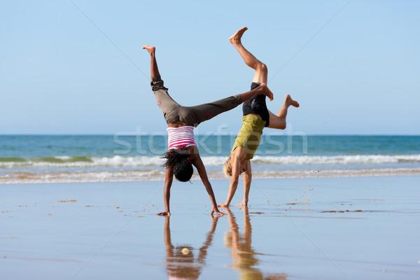 Spor çift jimnastik plaj genç kafkas Stok fotoğraf © Kzenon