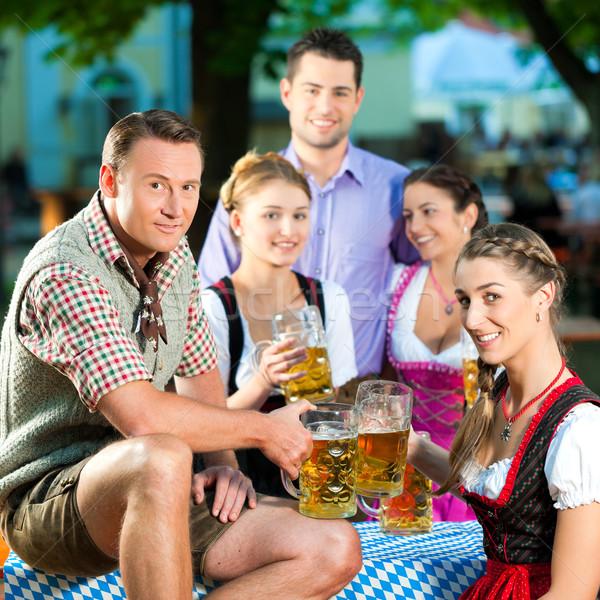 In Beer garden - friends drinking beer Stock photo © Kzenon