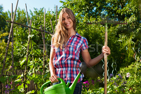 Gardening in summer - woman with grate Stock photo © Kzenon