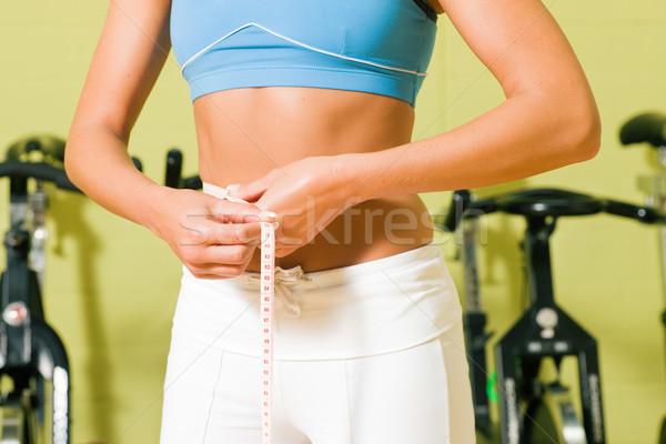Measuring waist Stock photo © Kzenon