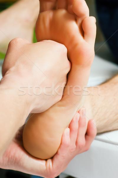 Foot massage with fist Stock photo © Kzenon