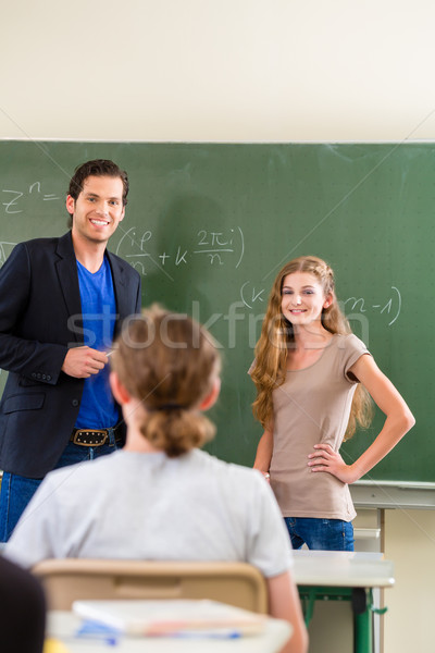Teacher testing  student  in math lessons in school class Stock photo © Kzenon