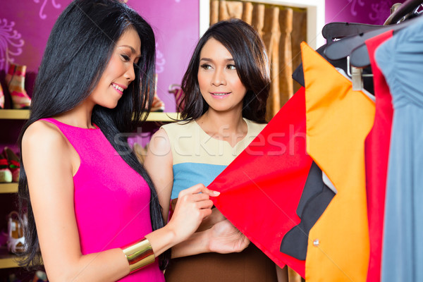 Asian friends shopping in fashion store Stock photo © Kzenon