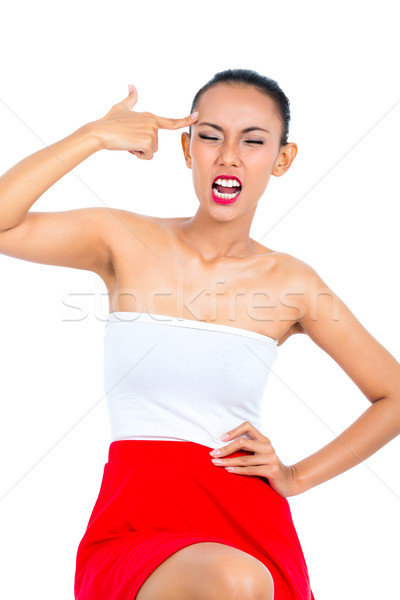 Stock photo: Asian woman showing idiot sign