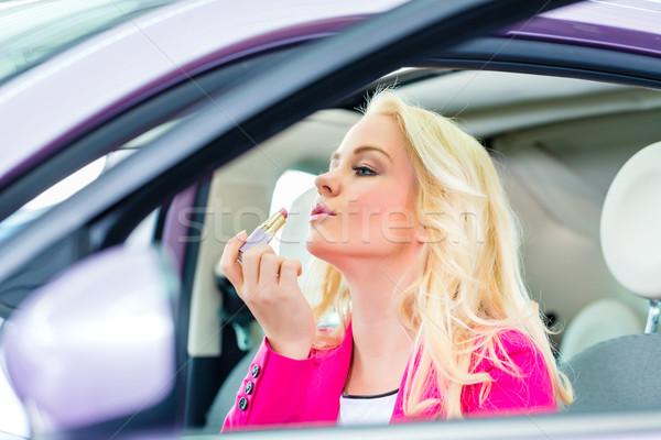 Woman doing her makeup in car  Stock photo © Kzenon