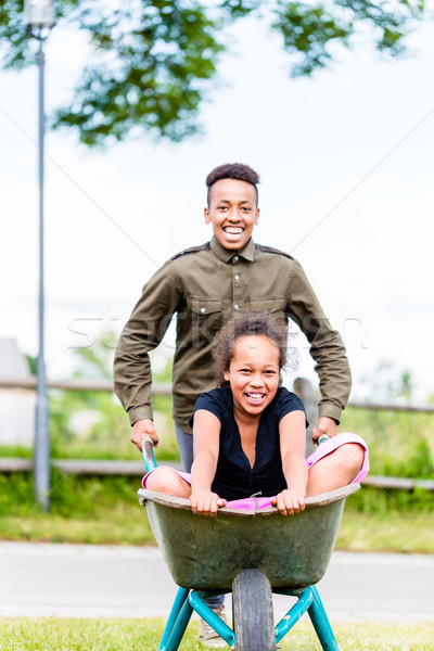 Stock photo: Siblings playing together in garden