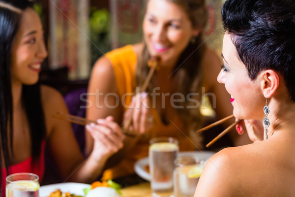 Young people eating in Asia restaurant Stock photo © Kzenon