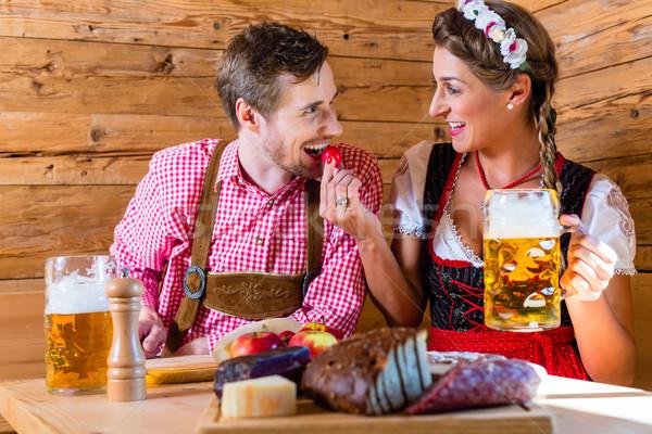 Couple having dinner at mountain hut in alps Stock photo © Kzenon