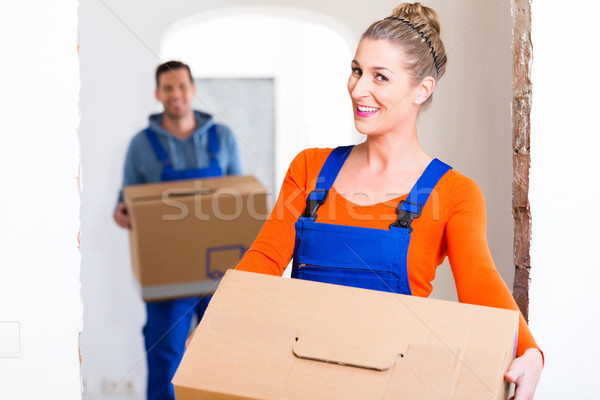 Woman and man moving in new home with boxes Stock photo © Kzenon