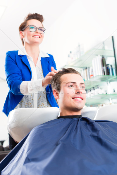Hairdresser advice man on haircut in barbershop Stock photo © Kzenon
