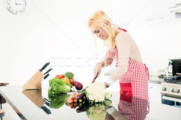 Asian woman cooking food Stock photo © Kzenon