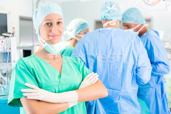 Stock photo: Surgeons operating patient in operation theater