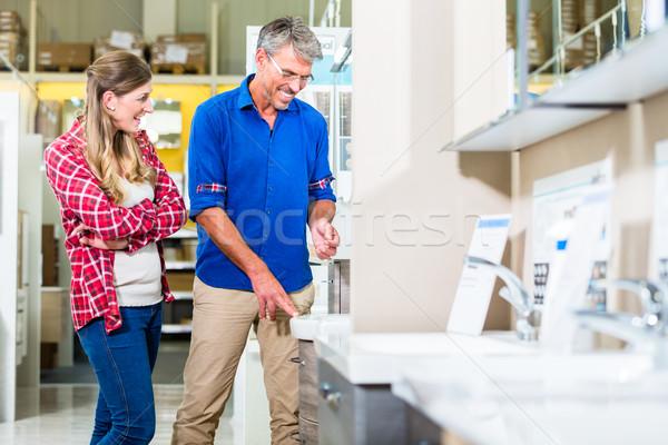 Magasin assistant matériel magasin client eau Photo stock © Kzenon