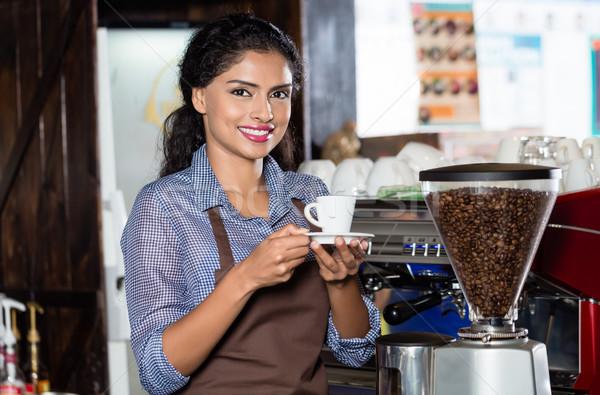 Indian barista offering coffee Stock photo © Kzenon