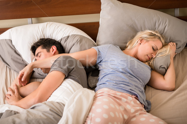 Joven mujer dormir vista hombre noche Foto stock © Kzenon