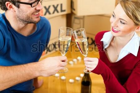 Couple clinking with sparkling wine for Christmas Stock photo © Kzenon