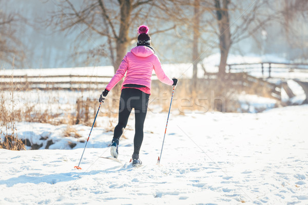 Woman doing cross country skiing as winter sport Stock photo © Kzenon
