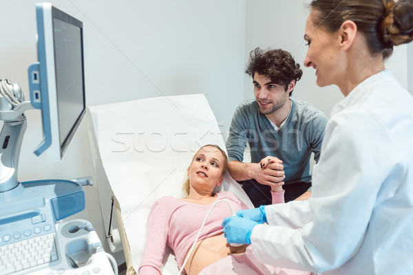 Couple in reproduction clinic being happy as the wife is pregnan Stock photo © Kzenon