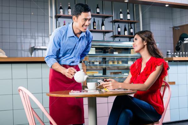 Guapo camarero coquetear mujer hermosa café Foto stock © Kzenon