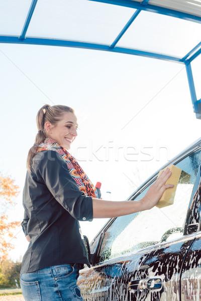 Woman foaming her car  Stock photo © Kzenon