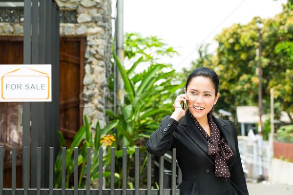 Asian Realtor presenting a new home Stock photo © Kzenon