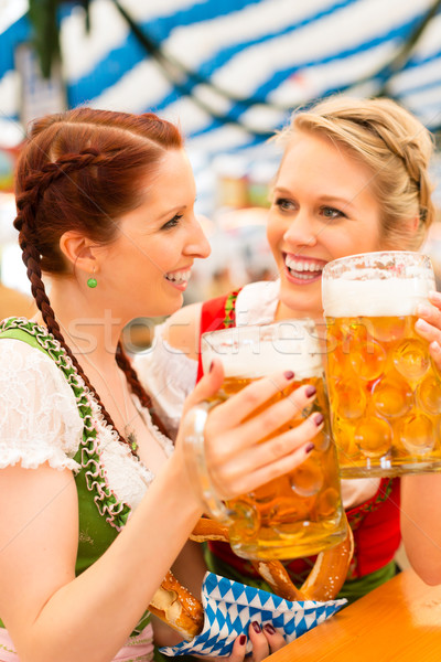 Women with traditional Bavarian dirndl in beer tent Stock photo © Kzenon