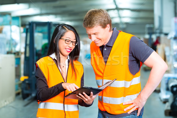 Forklift driver and supervisor at warehouse Stock photo © Kzenon