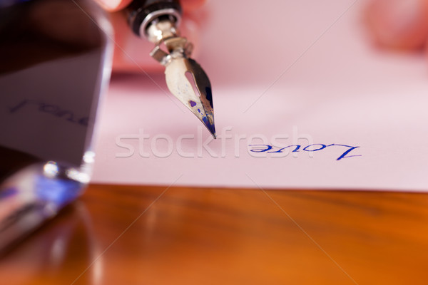 person writing a love letter with pen and ink Stock photo © Kzenon