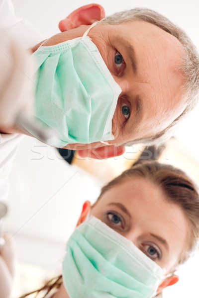 Dentist, Assistant and drill in a treatment Stock photo © Kzenon