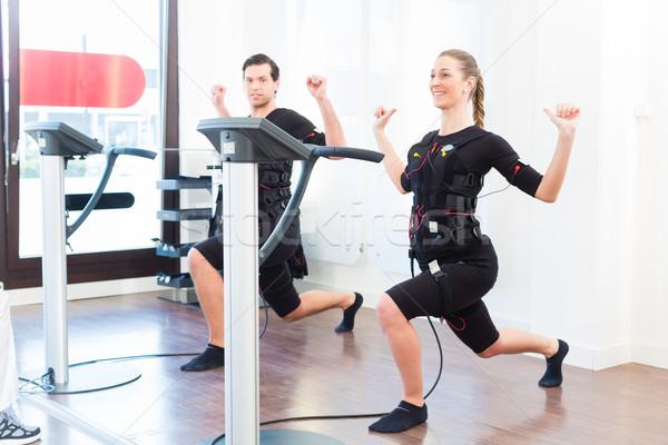 Man and woman having ems training Stock photo © Kzenon