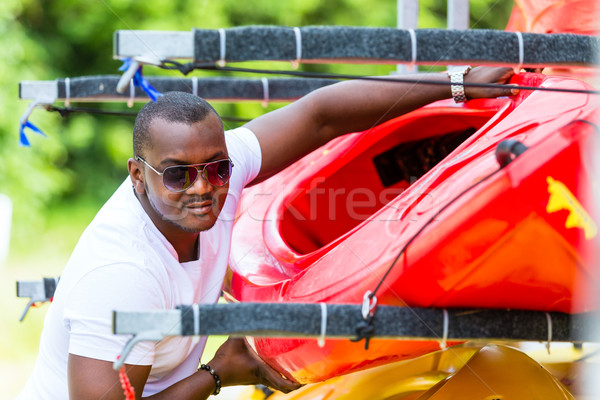 African man unloading boat from trailer Stock photo © Kzenon