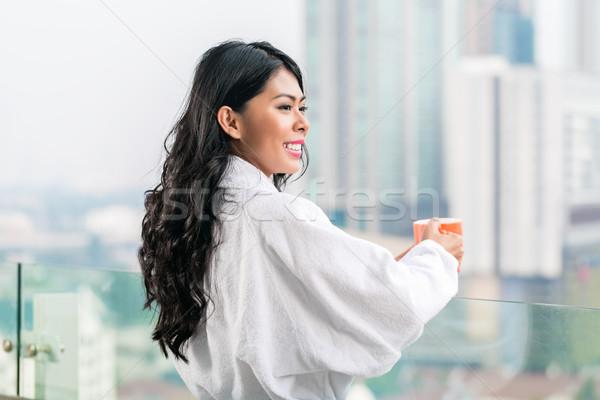 Asian woman in morning front of city skyline Stock photo © Kzenon