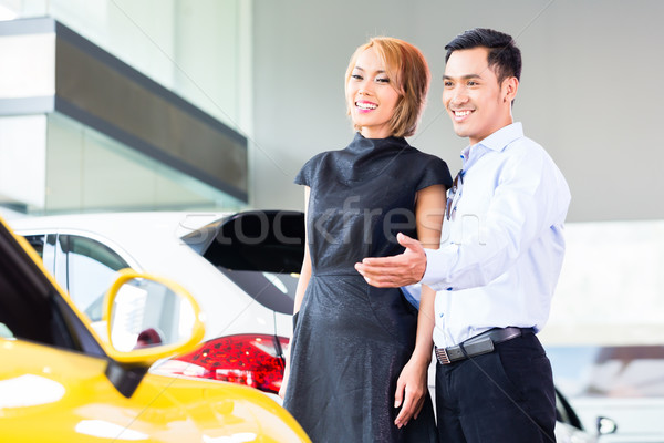 Asian couple choosing car in dealership Stock photo © Kzenon